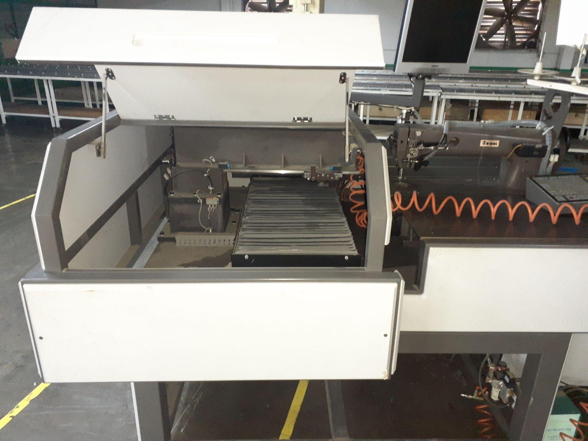 Lot 150 - Máquina de coser industrial computarizada de alto rendimiento marca Orisol, Modelo: OS-305
