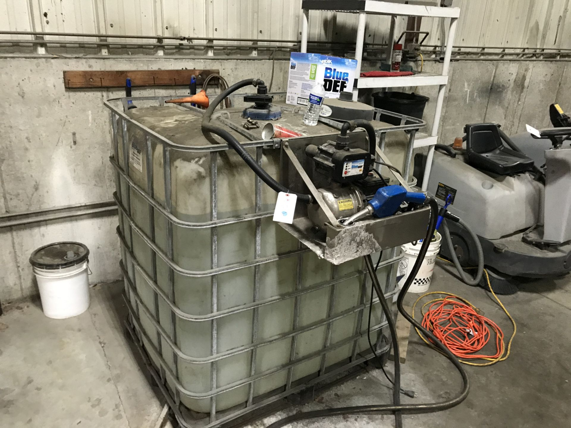 Lot 28 - {LOT} 330 Gallon Tote w/Approx 275 Gallons of Blue Def Blue Diesel Exhaust Fluid w/Pump