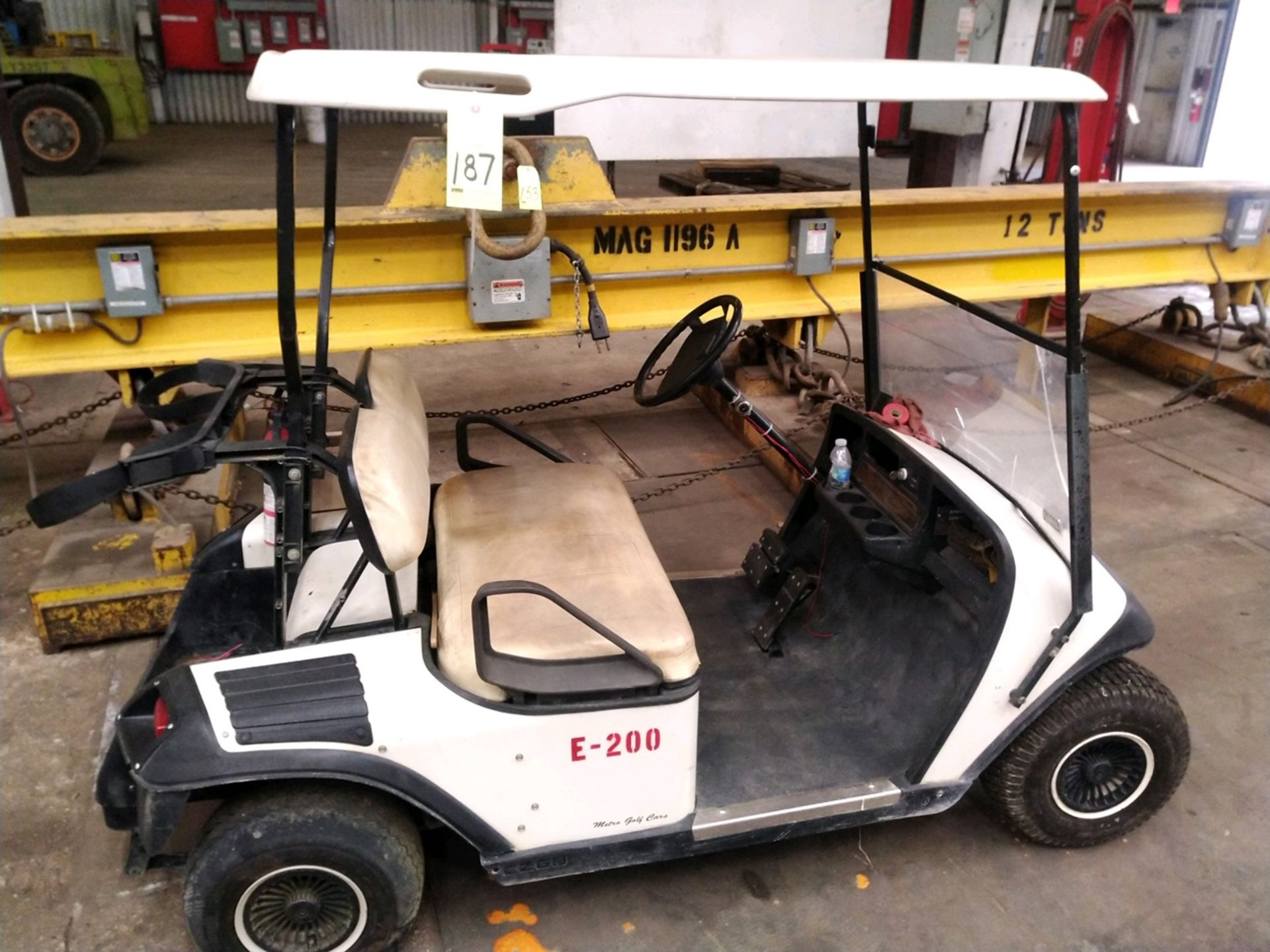 Lot 187 - ELECTRIC GOLF CART, EZ-GO, 36 v., w/charger (in need of repair)