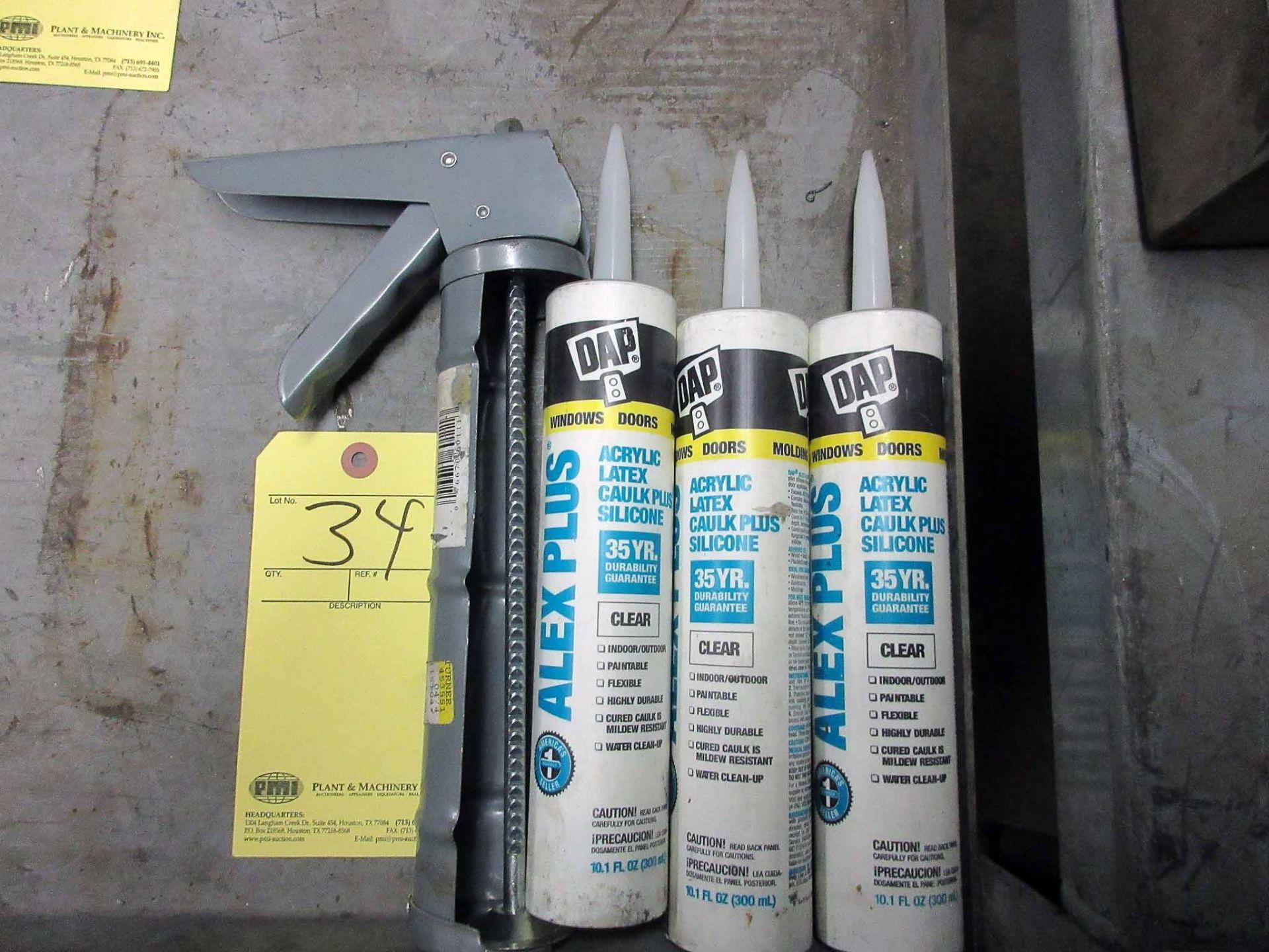 Lot 34 - CAULK GUN, w/(3) tubes of caulk