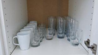 LOT OF KITCHENWARE INCLUDING MUGS, PLATES, GLASSWARE, PITCHERS, UTENSILS, ETC.