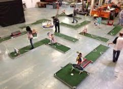9-Hole Mini Golf System Complete with Obstacles, Putters, Golf Balls nad Storage Rack on Wheels
