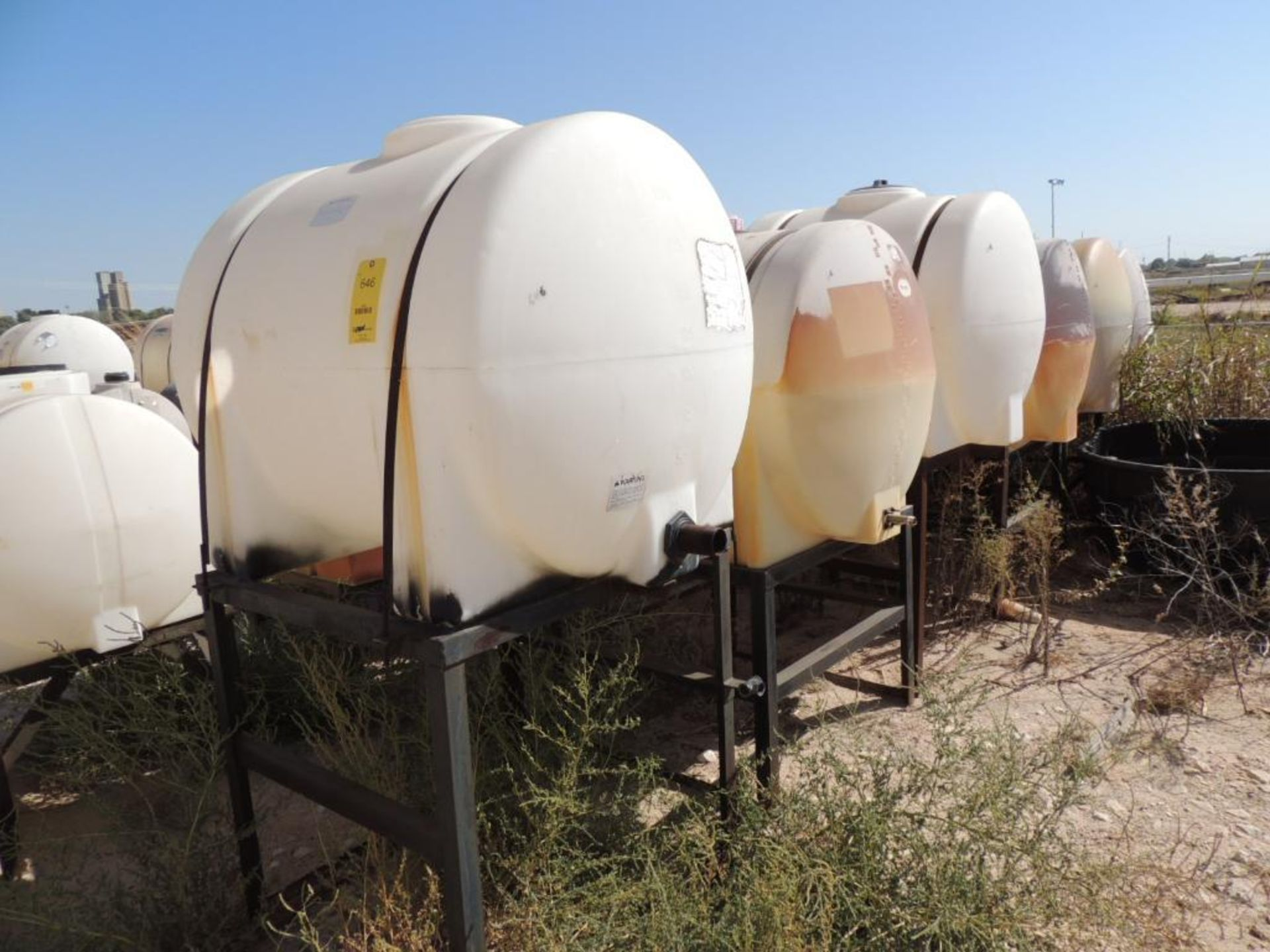 LOT: (6) Poly Tanks - (4) 230 Gallon, (2) 225 Gallon (LOCATED IN HENNESSEY, OK. - IN CHEM YARD)
