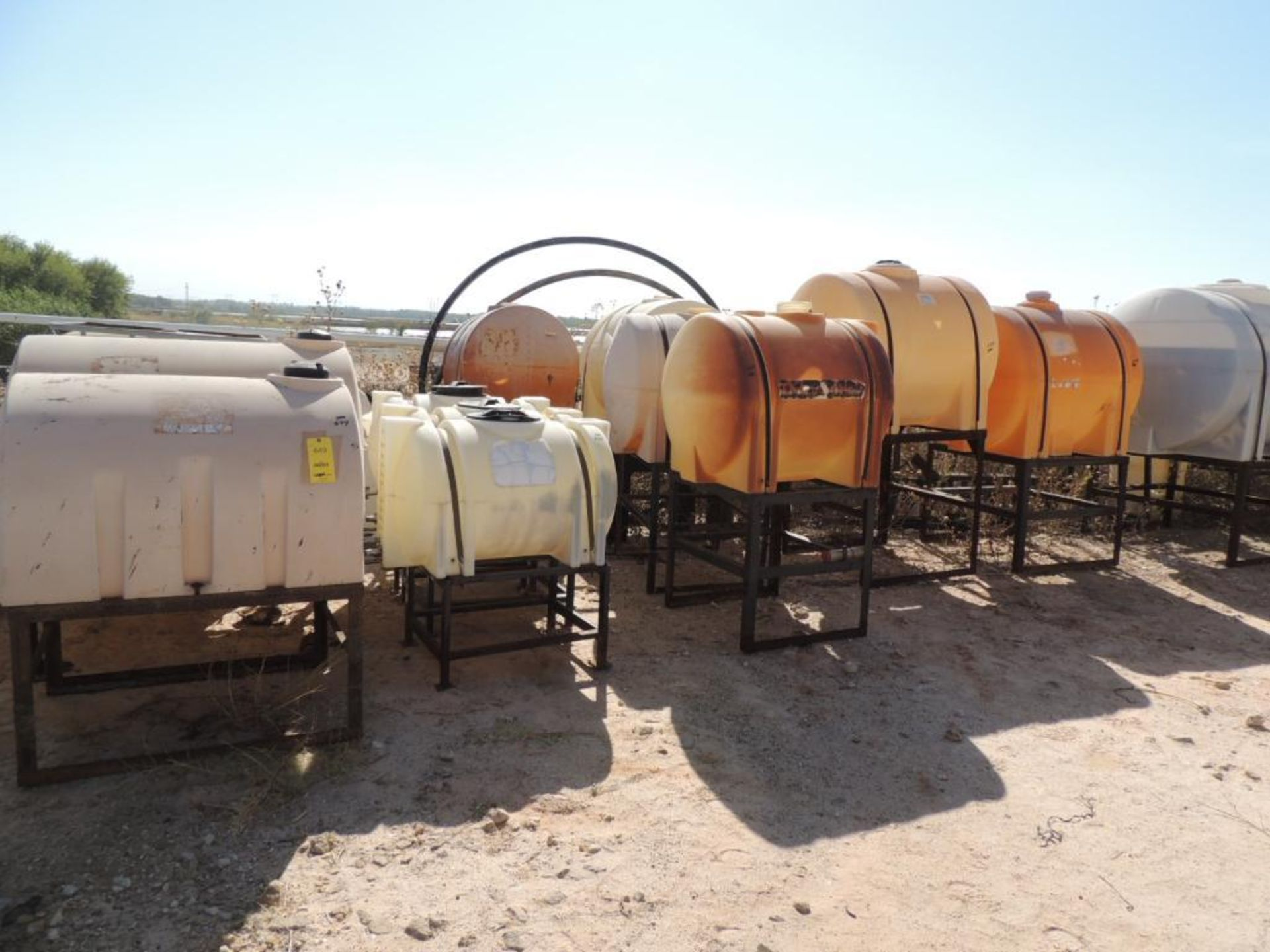 LOT: (10) Poly Tanks - (1) 535 Gallon, (2) 225 Gallon, (1) 220 Gallon, (3) 130 Gallon, (3) 65 Gallon