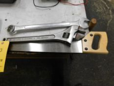 LOT: (1) 18 in. Crescent Wrench, (1) 1-7/16 in. Combination Wrench, (1) Sledge Hammer, (1) Saw (LOCA