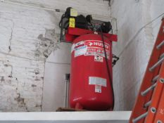 HUSKY 7 HP UPRIGHT AIR COMPRESSOR W/80 GALLON TANK MOUNTED ON 8 FT. SHELF ABOVE FLOOR LEVEL