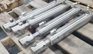Lot of (7) S/S Hydraulic cylinders