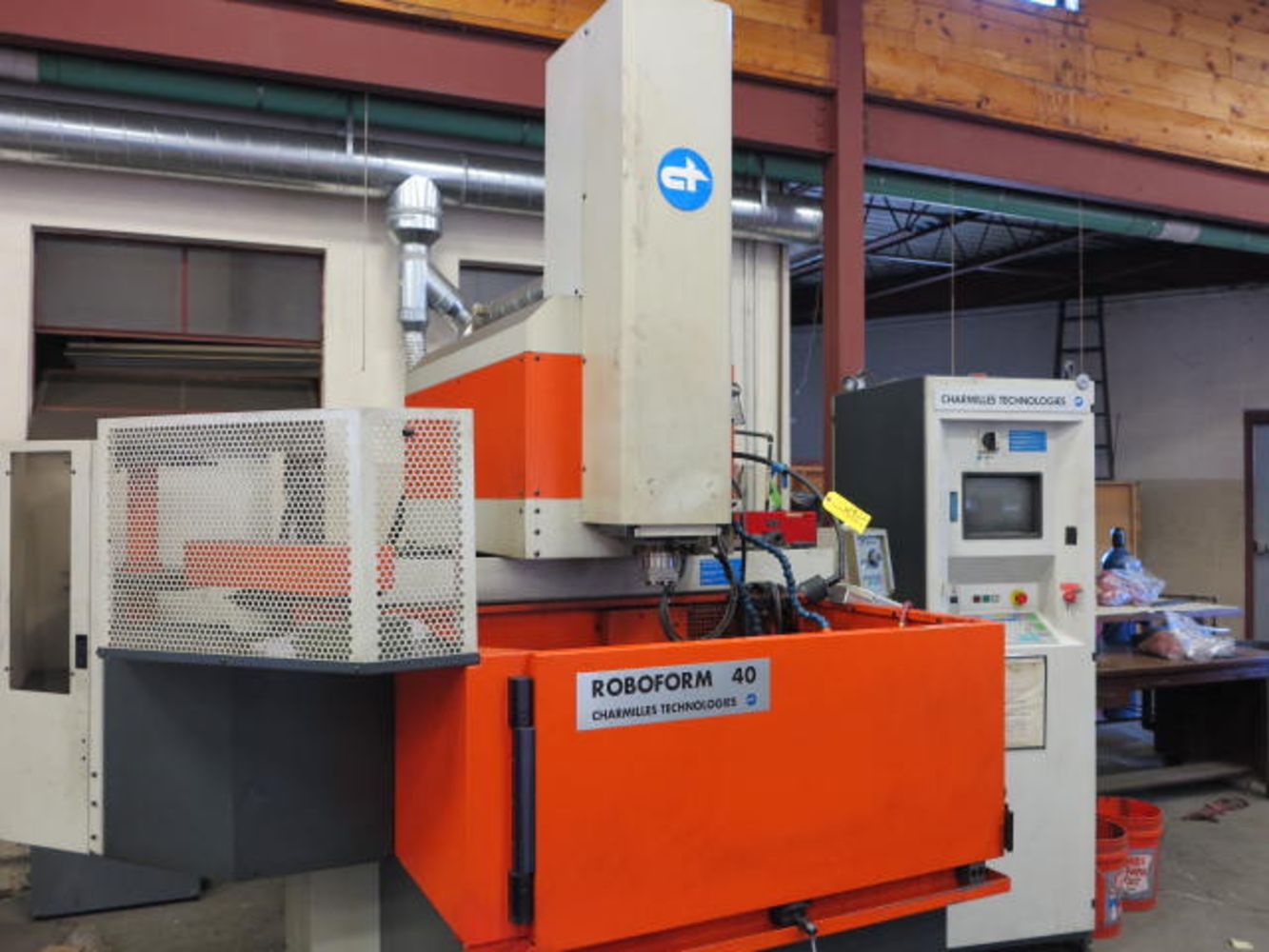 3, 4 & 5 Axis CNC Machine Tools, Blanchard Grinders, Charmille Roboform EDMS, Lathes, Mills, Raidal Arm Mills of Newport Tool & Die, Inc.