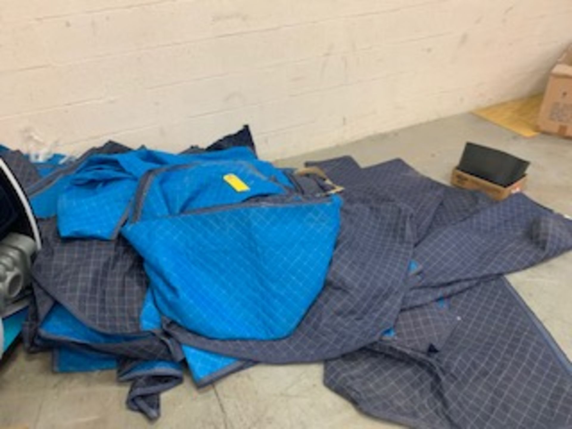 Lot 216B - LARGE LOT - ASSORTED SUPPLIES, SHIPPING BLANKETS, MOTORS, COPIER, SAW HORSES, ETC
