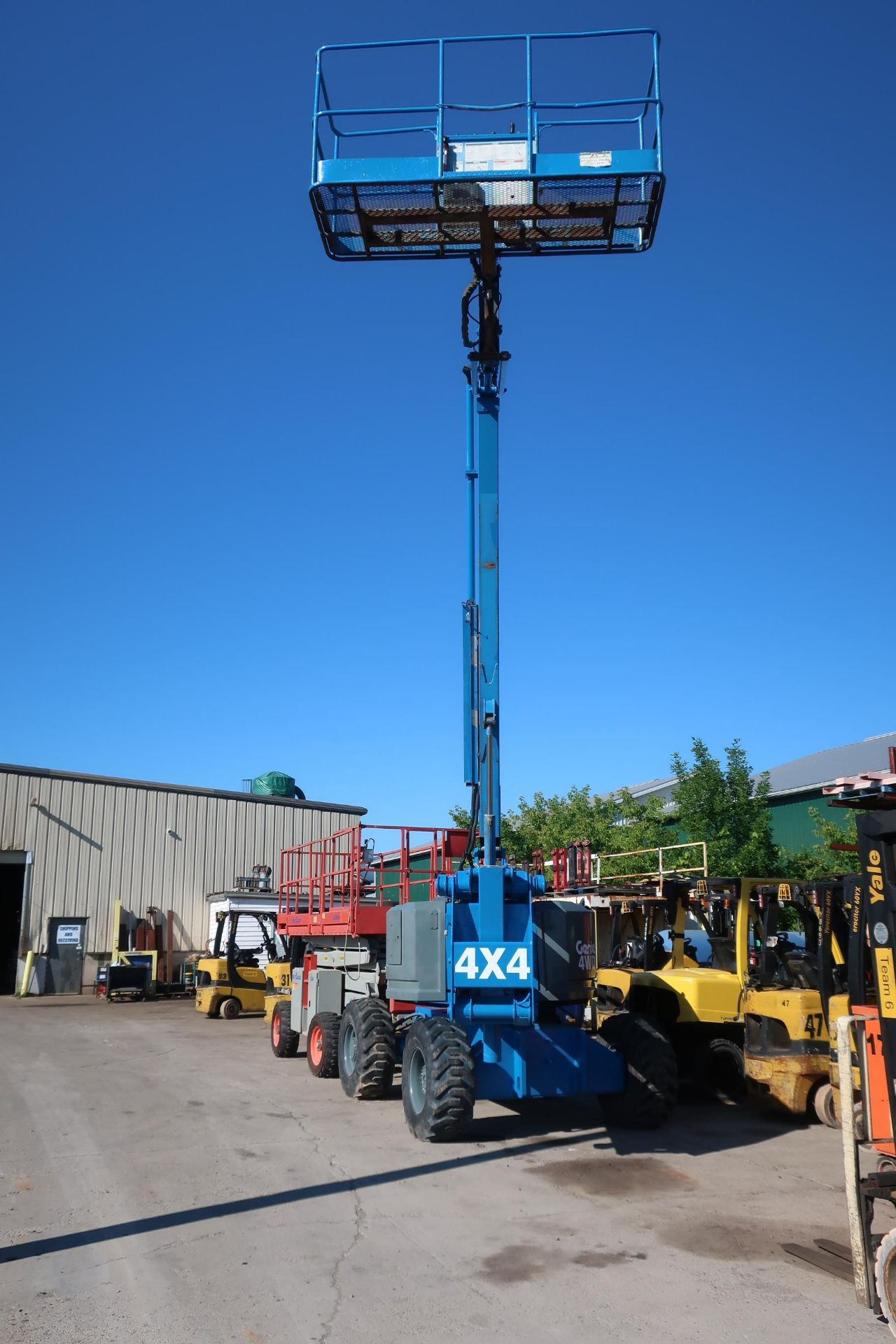 Lot 2 - MINT Genie Boom Lift model Z-60/34 with 60' platform height with LOW hours
