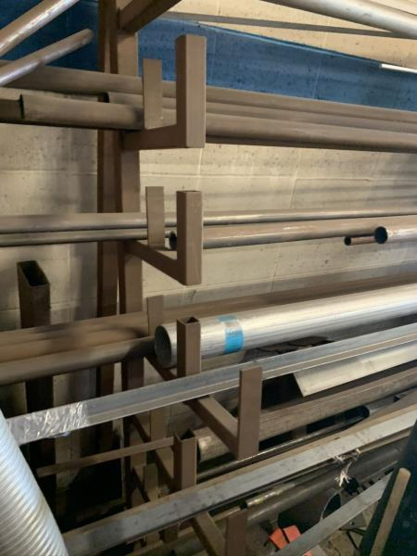 Lot 6 - Eight tier cantalever metal stock rack, contents of steel & Alumium inventory with (5) red piles