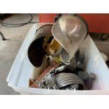 Welding helmets, caution tape, knee pads, motor oil