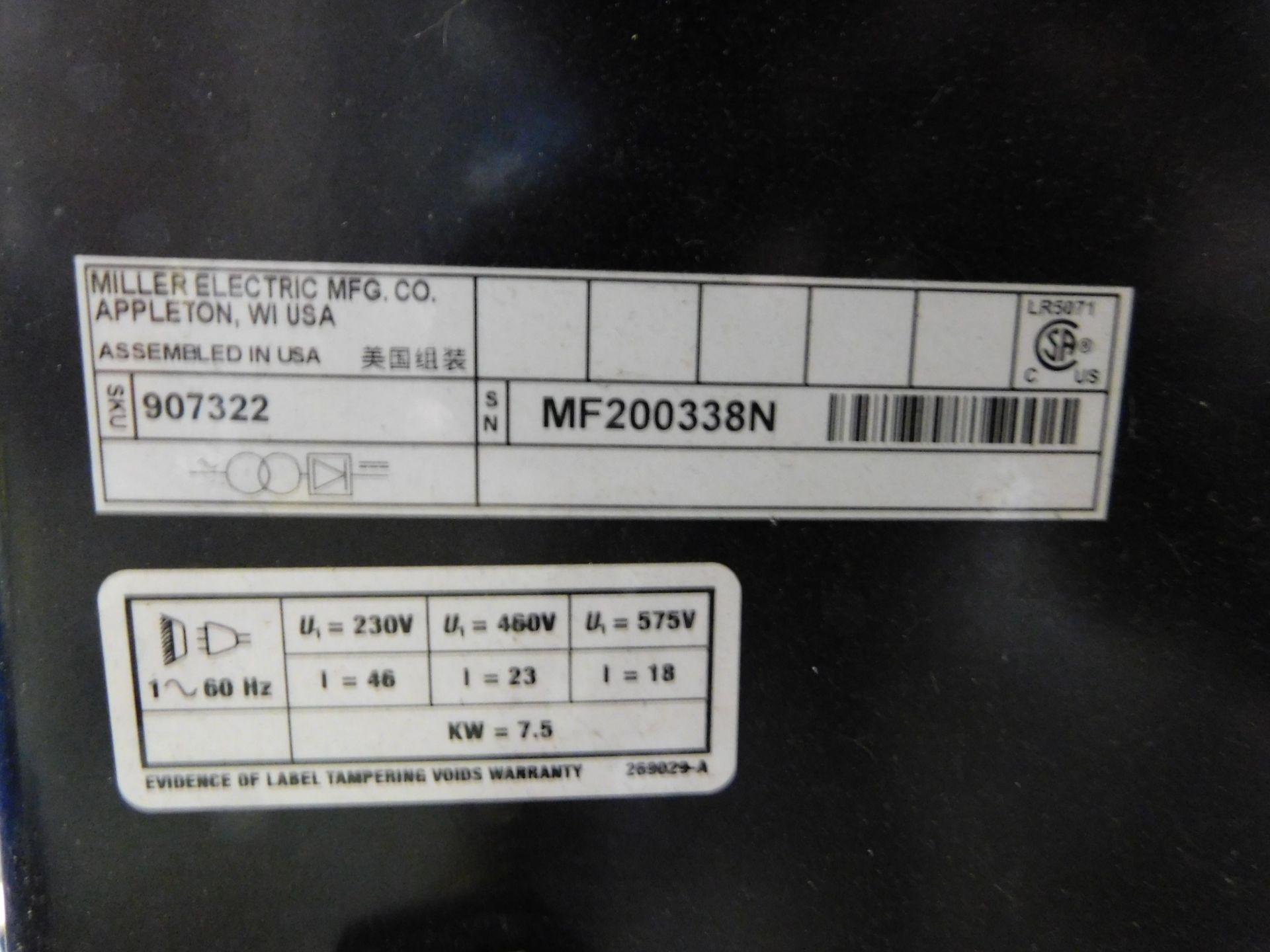 Lot 114 - Miller Millermatic 252 Mig Welder, SN MF200338N, with Mig Gun, Ground Cable, and Regulator, 220V,