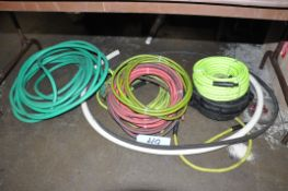 Lot-Water and Air Hose on Floor Under (1) Table