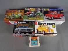 AMT, Revell - Six boxed plastic model car and accessory kits in 1:25 scale.