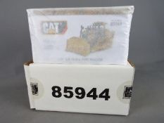 Diecast Masters - A boxed 1:50 scale #85944 Cat D19T Track -Type Tractor by Diecast Masters.