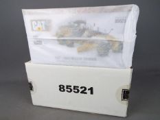 Diecast Masters - A boxed 1:50 scale #85521 Cat 18M3 Motor Grader by Diecast Masters.