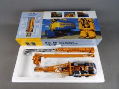 BYMO - A boxed diecast 1:50 scale BYMO Bauer BG40 Rotary Drilling Rig with BC40 Trenchcutter.
