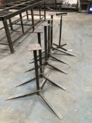 7 adjustable height heavy duty steel tripod stands and a roller stand