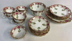 A Chapman England Floral Bone China Tea set, comprising of 6 cups and saucers, 6 side plates and 2