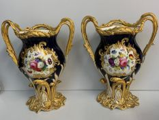 A pair of H&R Daniel Baroque Vases glazed blue with gilded handles and laurels, slight hairline