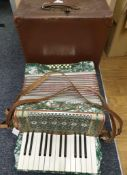 A Vintage 'Rosetts' Accordian, Bellows in good working order but one key needs a new spring, comes