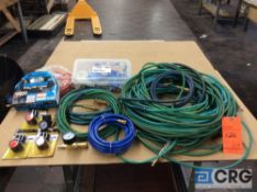 Lot of assorted air hoses, air compressor regulators with gauge, assorted spare parts
