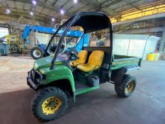 John Deere Gator gas 4 X 4 (620) utility vehicle with bed, 1,683 hrs.