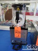 Frozen drink mixing machine