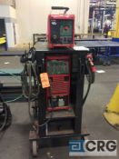 Fronius portable welder including TRANSPULS SYNERGIC 4000 power source and welder wire feed