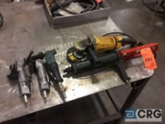 Lot of hand tools including pneumatic grinders, electric grinder, pneumatic caulking gun, hand