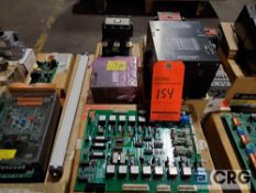 Lot of assorted electrical parts including, circuit boards, contacts, electronic controls, small