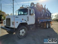 1986 Mack DM686S tandem axle Liquid Vac Truck, 65,000 GVWR, 1,079 hours, with 4,000 gal. capacity