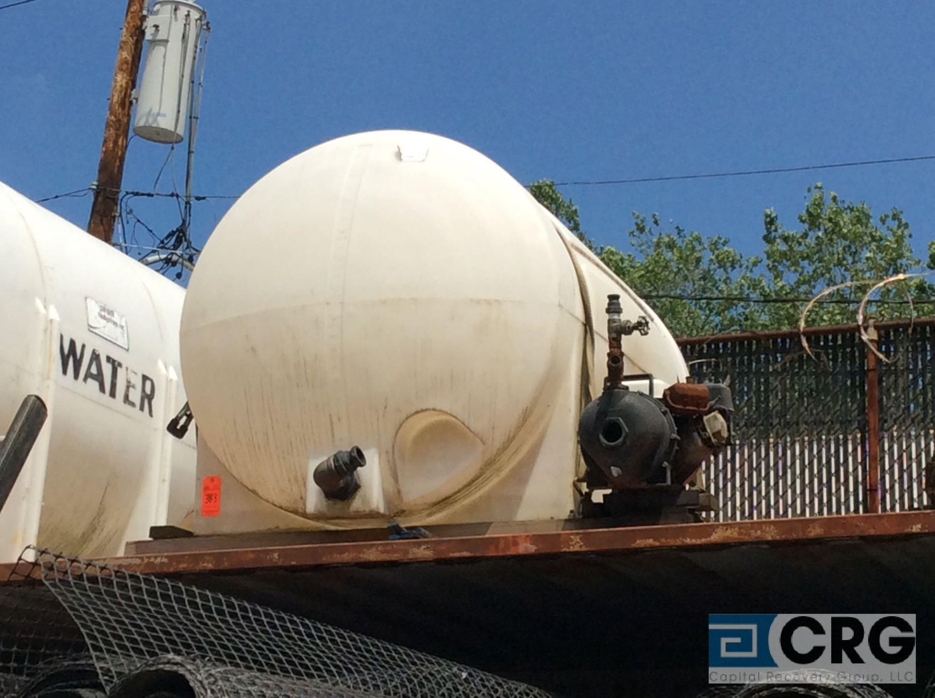 Lot 383 - approx 300 gal water storage tank with attached pump
