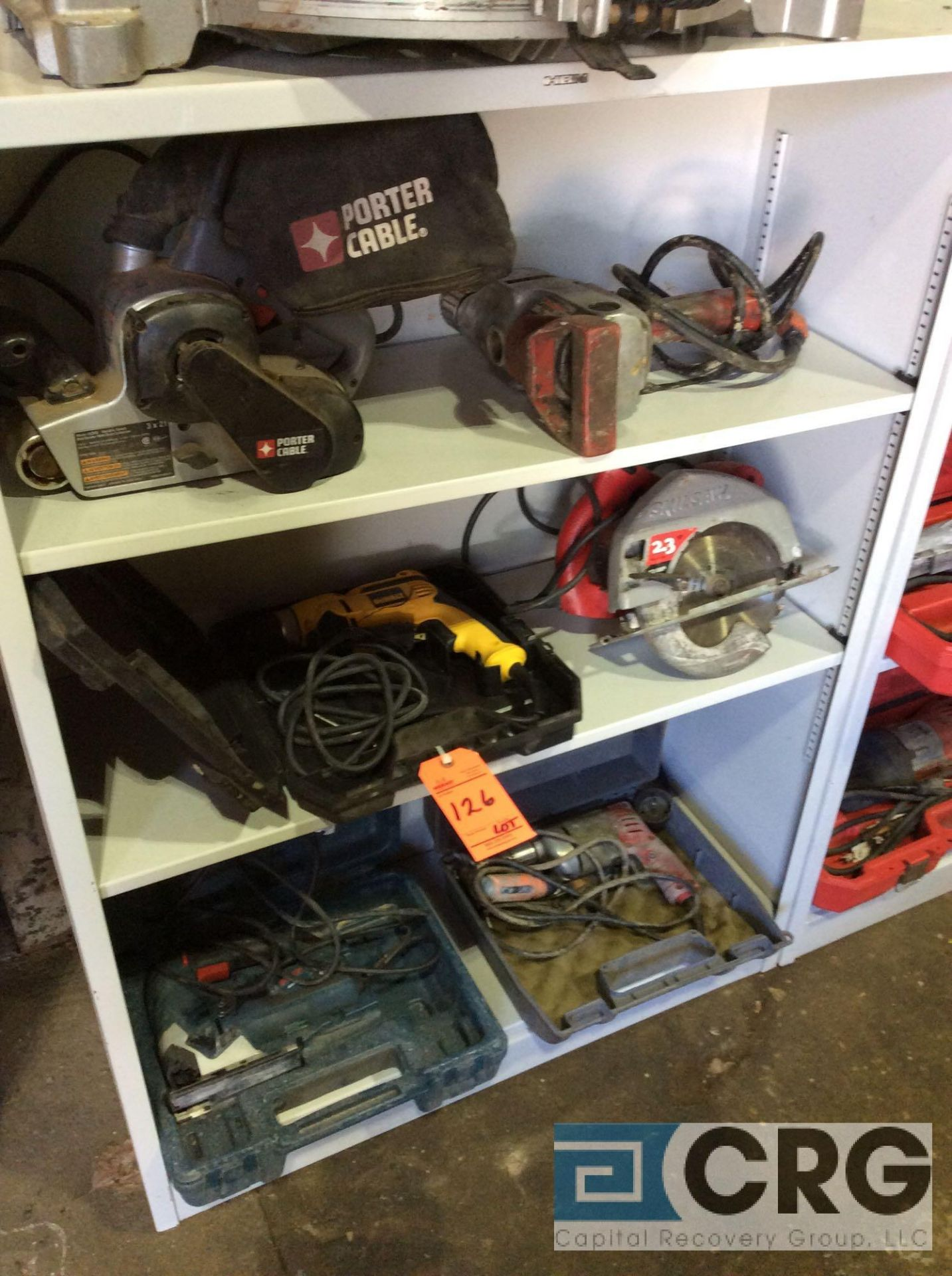 Lot 126 - Lot of asst hand tools including sawzalls, drills, circular saws, jig saws, belt sanders, etc (