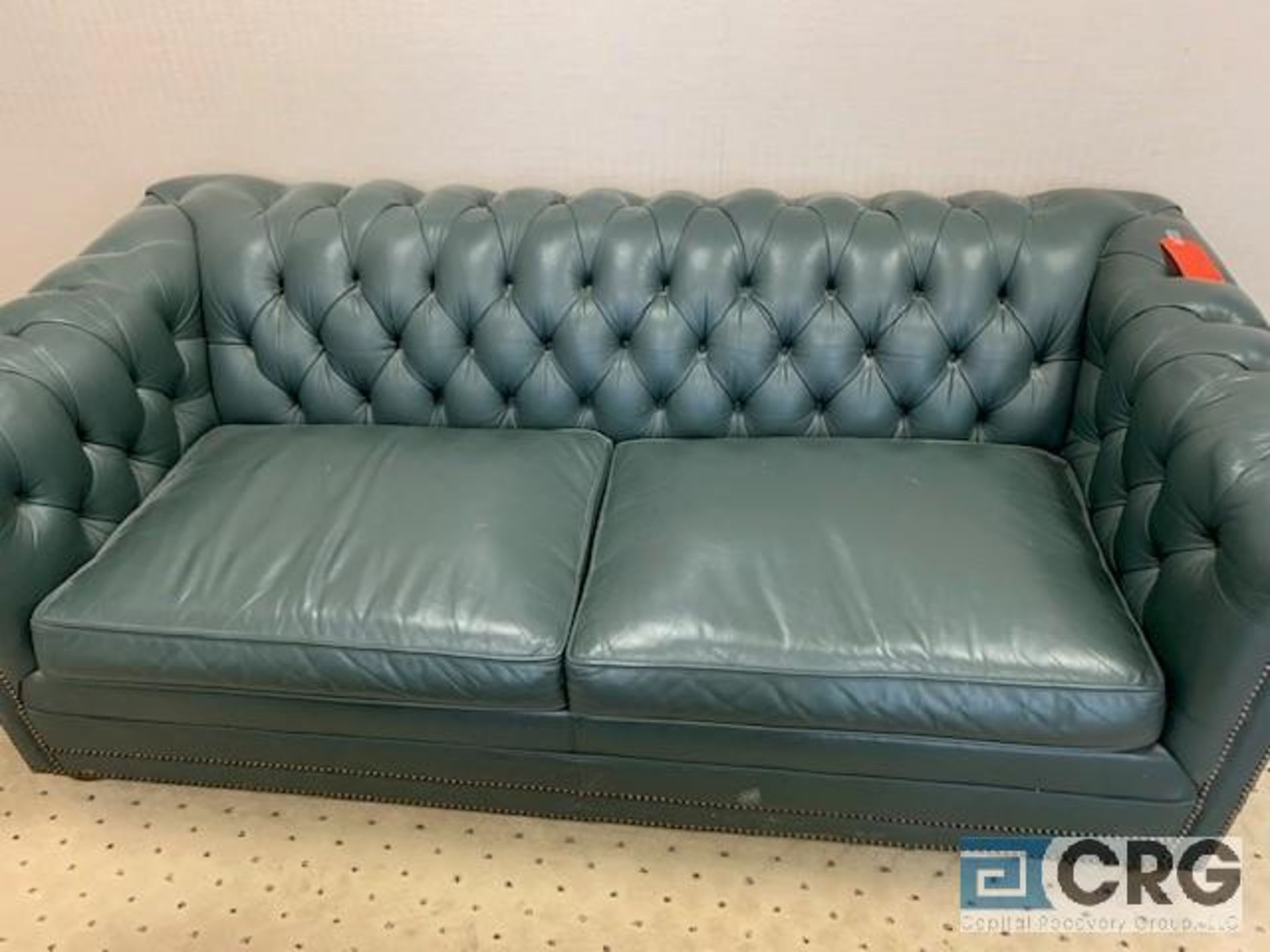 Lot 535 - 6 foot leather sofa with arm chair and coffee table