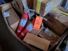 Lot of assorted parts, including CAT parts, OshKosh truck parts, and fire extinguishers
