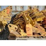 Lot of assorted cat parts, including (1) Cat 6J-8814 shank protector, (2) 8E-2469 corner adapter lef