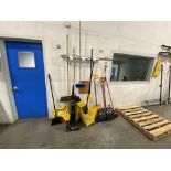 Lot of assorted cleaning and maintanence supplies including brooms and brushes, snow shovels,