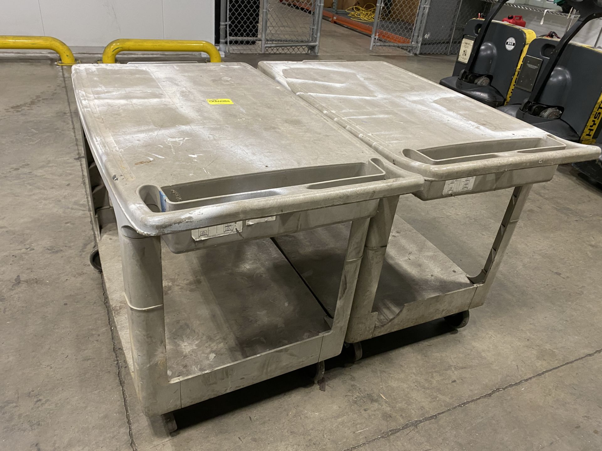 """Lot of (2) Rubbermaid hard plastic rolling two-tier carts, 36"""" X 24"""""""