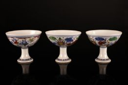 Arte Cinese Three ducai porcelain cups painted with fishes in pond and children and bearing undergl