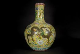Arte Cinese A large globular porcelain tiaqiuping vase over yellow groundChina, 20th century.