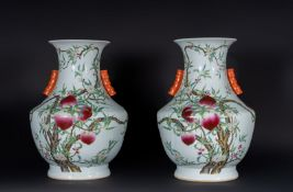 Arte Cinese Pair of monumental thouhu vases decorated with peaches and flowers China, early 20th ce