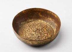 Arte Islamica A gilded copper (tombak) hammam bowl embossed with a star shaped lattice patternOttom