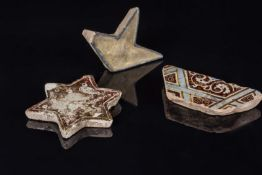 Arte Islamica A lot composed of three Islamic star tile fragmentsIran, 12th - 14th century .