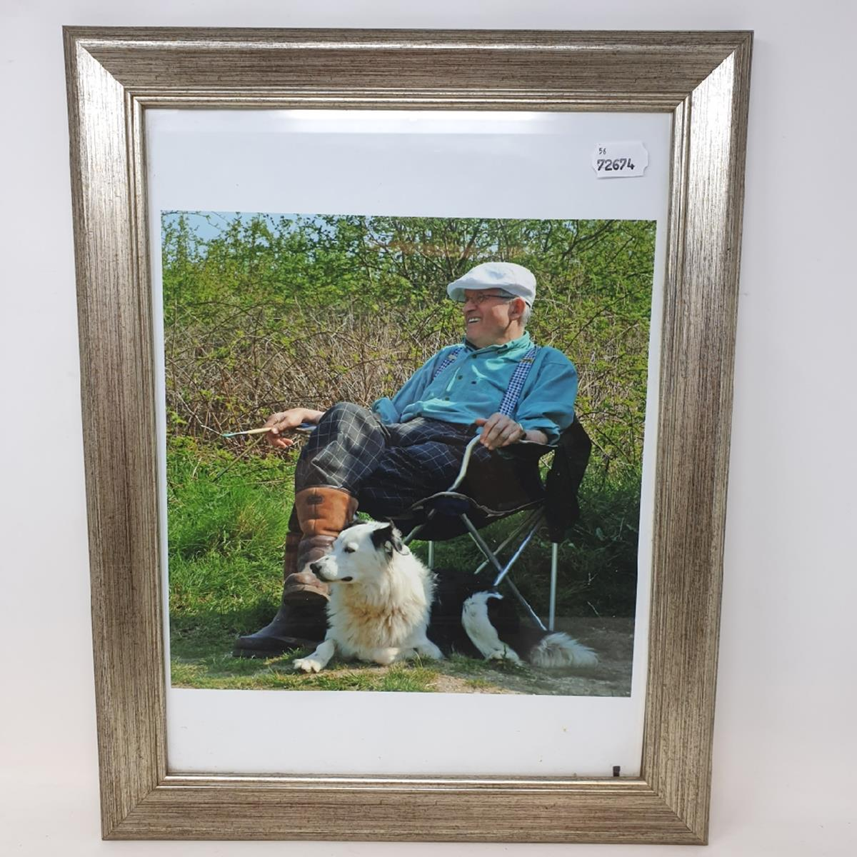 Lot 39 - Six assorted photographs and prints, including a printed image of David Hockney sitting next to a