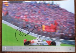 A colour poster of a Mercedes Benz GP car racing at Imola driven by David Coulthard, signed, and