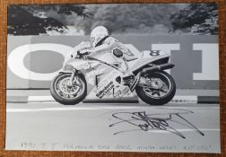 A period black and white photograph of Carl Fogarty competing at the 1991 TT Formula One race on the