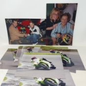 An assortment of coloured photographs relating to Chris Walker aboard his Kawasaki (qty)
