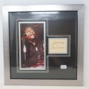 A Fats Domino presentation, featuring colour photograph and signature